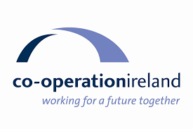Co-operation Ireland Logo, the peace building charity led by Chairman, Dr. Christopher Moran and CEO Peter Sheridan