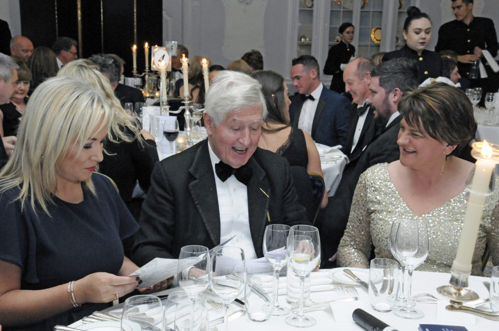 (L-R) Michelle O'Neill, Sinn Féin, Dr Moran and DUP Leader Arlene Foster share a laugh at the Co-operation Ireland Chairman's Dinner