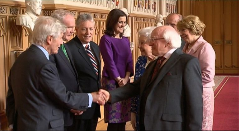 (L-R) Dr. Christopher Moran, Former Deputy First Minister Martin McGuinness, Her Majesty The Queen, His Excellency The President of Ireland Michael D. Higgins shake hands upon Irish State Visit, joined by His Royal Highness The Prince Philip, Duke of Edinburgh; Mrs. Sabina Higgins; and Secretary of State for Norther Ireland Theresa Villiers